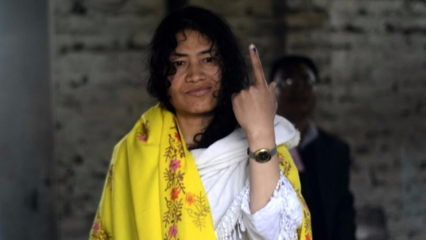 Manipuri rights activist Irom Sharmila shows her forefinger marked with phosphorus ink after casting her vote.  (Photo: IANS)