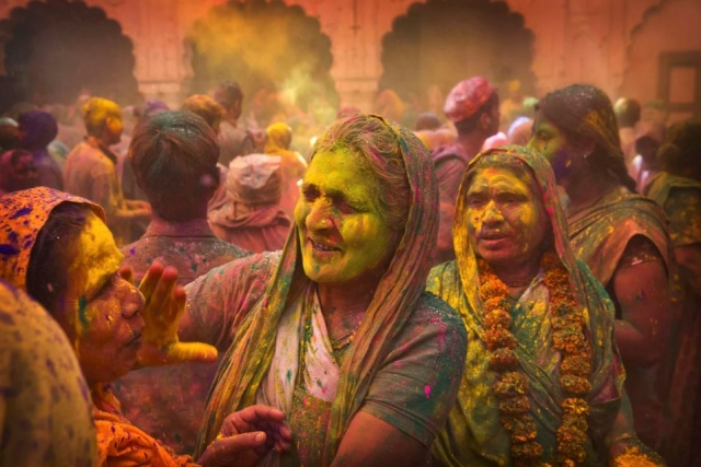 Widows apply colour to each other during Holi celebrations. (Photo: AP)