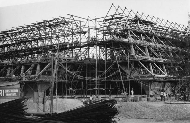 "Halls of Nations and Industries under construction. (Photo: Copyright Mahendra Raj Archive/(HELLANS Industrial & Pictorial Photographers, New Delhi) via<a href=""https://architexturez.net/doc/az-cf-123722"">Architexturez.net</a>)"