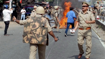 Police in action after a violence broke out during an Ambedkar Jayanti Shobha Yatra in Saharanpur on Thursday. (Photo: PTI)