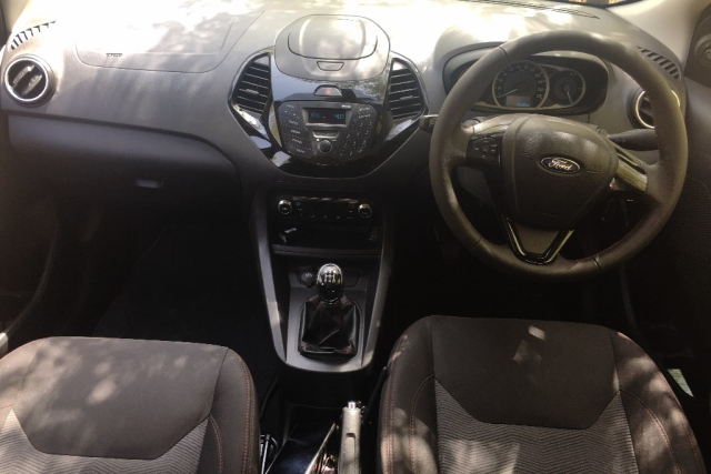 The red stitching seats are soft and comfortable, but what's with the console on the dashboard, Ford? The Figo Sports costs more than Rs 6 lakh, surely they could have given us a better infotainment system. This also means, we do not get a parking camera or sensor on this one.