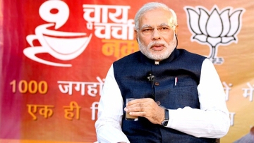 "(Photo Courtesy: <a href=""http://www.narendramodi.in/narendra-modi-the-people-of-india-a-cup-of-tea-grand-start-to-chai-pe-charcha-5964"">narendramodi.in</a>)"
