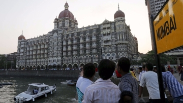 Tourists are seen in front of the Taj Mahal hotel, which was one of the targets of the November 26, 2008 attacks, in Mumbai April 10, 2015. (Photo: Reuters)