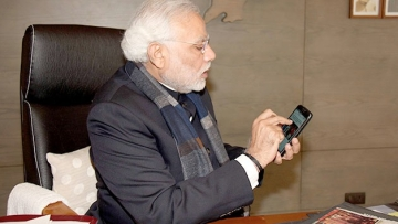 "(Photo Courtesy: <a href=""http://www.narendramodi.in/mobile-application-for-india272-launched-by-shri-narendra-modi-5849"">narendramodi.in</a>)"