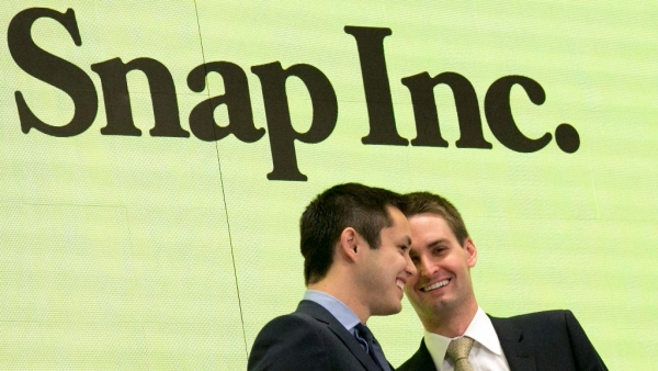A file photo of Snapchat co-founders Bobby Murphy, left, and Evan Spiegel ringing the opening bell at the New York Stock Exchange.