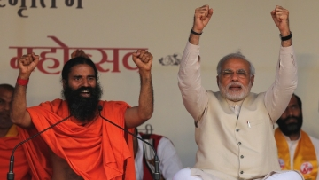 Baba Ramdev <i>(left)</i> with Prime Minister Narendra Modi (<i>right</i>) at a Yoga festival in New Delhi. (Photo: Reuters)