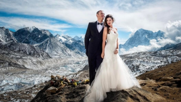 "Dressed in a tuxedo and a wedding dress, the couple exchanged their vows at 14,000 feet . (Photo: <a href=""https://www.instagram.com/p/BTIBWQADmnO/?taken-by=charletonchurchill"">Instagram</a>)"