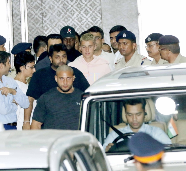 Justin Bieber arrives at Kalina airport with his team ahead of his concert tonight. (Photo: Yogen Shah)