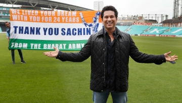 Sachin Tendulkar poses for a photograph on the pitch at the Oval cricket ground in London. (Photo: AP)