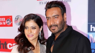 Kajol at an event with Ajay Devgn.