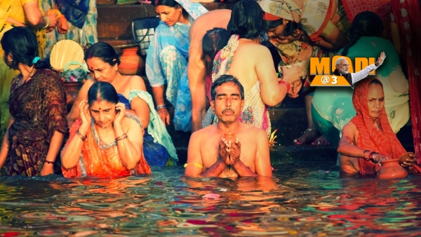 The young and old celebrate the confluence of ignorance towards filth and religious fervour with a dip into the Ganga.