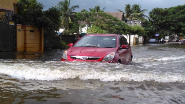 Driving through flooded streets needs caution. (Photo courtesy: The News Minute)
