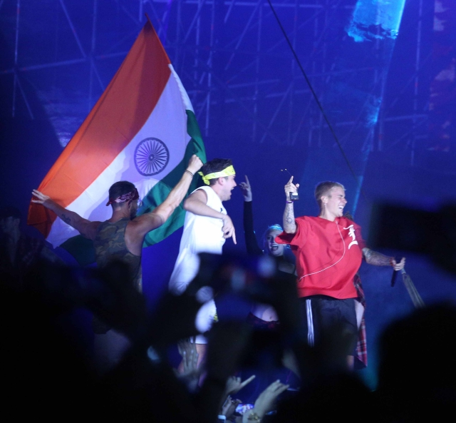 Justin on stage as they wave India's flag. (Photo: Yogen Shah)