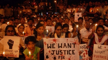 A file photo of an anti-rape candle march.