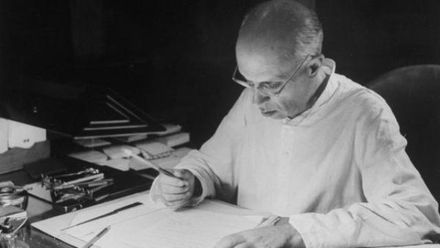 A rare photo of Nehru writing at his desk at Anand Bhawan.