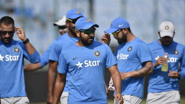 Rohit Sharma (centre) along with Ajinkya Rahane can certainly be a calming influence on the excitable Virat Kohli in Tests.