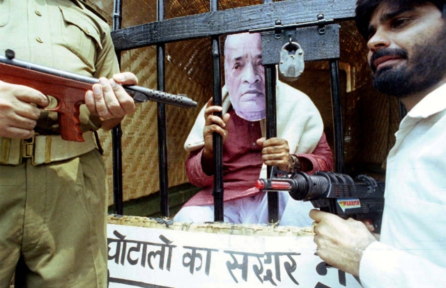 A demonstrator posing as former Indian prime minister and Congress Party leader PV Narasimha Rao sits inside a fake jail cell during a demonstration organised by dissident congress workers in New Delhi August 2. The dissidents were demanding Rao quit as Party leader because of his alleged involvement in a notorious cheating case. (Photo: Reuters)