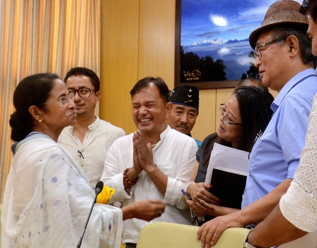 "West Bengal Chief Minister Mamata Banerjee addresses the media after a ""Peace Meeting"" with various Boards of Darjeeling & state chief secretary. (Photo: PTI)"