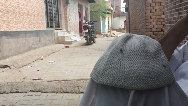 Brick-built warren of houses and the labyrinthine lanes of Khandawli, a village of 3,002 registered voters.