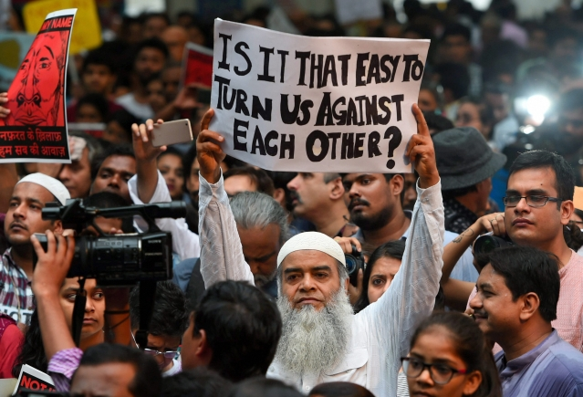 "A protester asks, ""Is it that easy to turn us against each other?"" at the 'Not in My Name' protest in New Delhi."