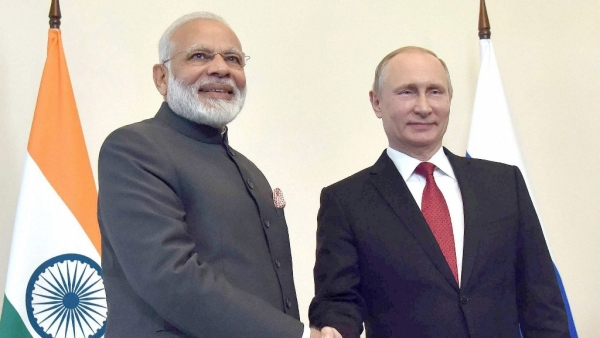 Prime Minister Narendra Modi shakes hands with Russian President Vladimir Putin, at the 18th India Russia Annual Summit.