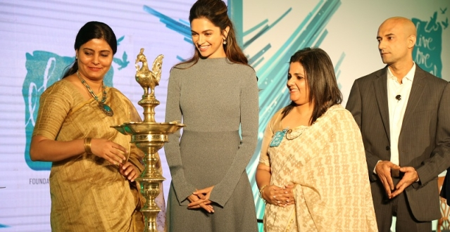 Deepika Padukone and Anna Chandy light the lamp with other members of The Live Love Laugh Foundation.