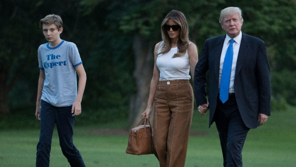 President Donald Trump, First Lady Melania Trump, and their son and Barron Trump walk from Marine One across the South Lawn to the White House in Washington on Sunday. (Photo: AP)