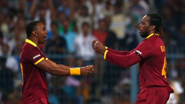 Dwayne Bravo and Chris Gayle celebrate a wicket during the ICC World T20 in 2016. (Photo: Reuters)