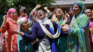 Family members and relatives mourn the death of Mohammed Ayub Pandith at his residence in Srinagar on Friday. (Photo: PTI)