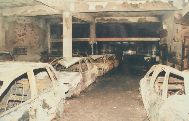 Remains of the burnt cars in the parking area of Uphaar Cinema.