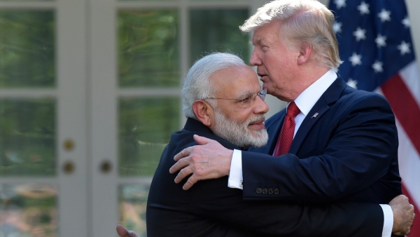 President Donald Trump and Indian Prime Minister Narendra Modi hug during a public address in the Rose Garden of the White House in Washington.