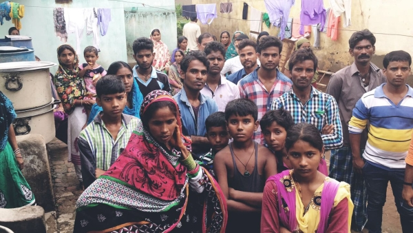 Villagers gather outside Ansari's house in Ramnagar district in Jharkhand. It took two attempts by the police to get the Ansari's family to take the body back. (Photo: Aishwarya S Iyer/<b>The Quint</b>)