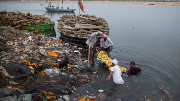 The polluted banks and waters of the river Ganga at Varanasi. Image used for representation.