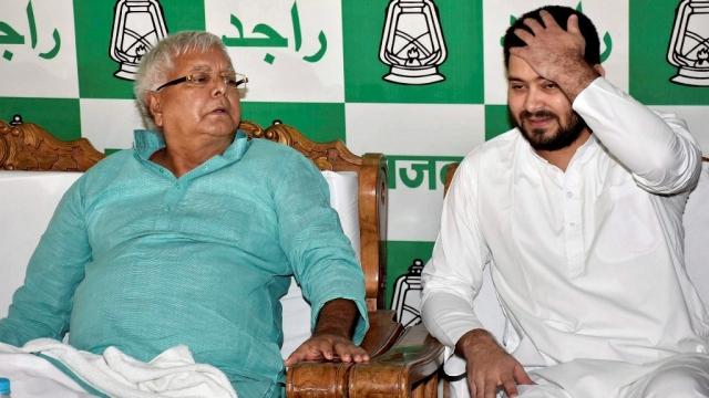 Lalu Prasad Yadav with his son  Tejashwi Yadav.