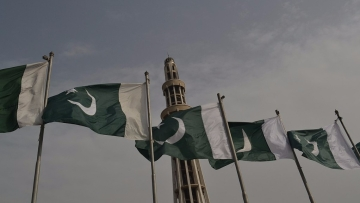 View of the Pakistani national flag fluttering in front of the Minar-e-Pakistan.