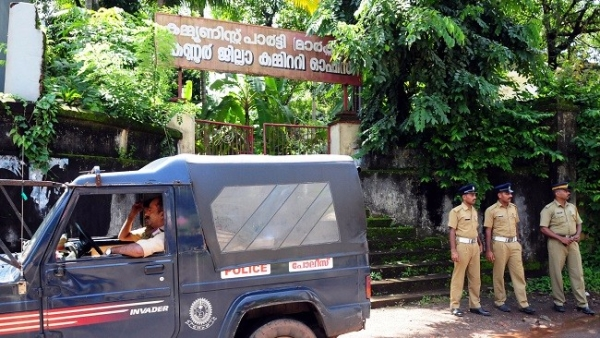 Police security outside CPI (M) office in Kannur in view of the multiple attacks in the capital city.