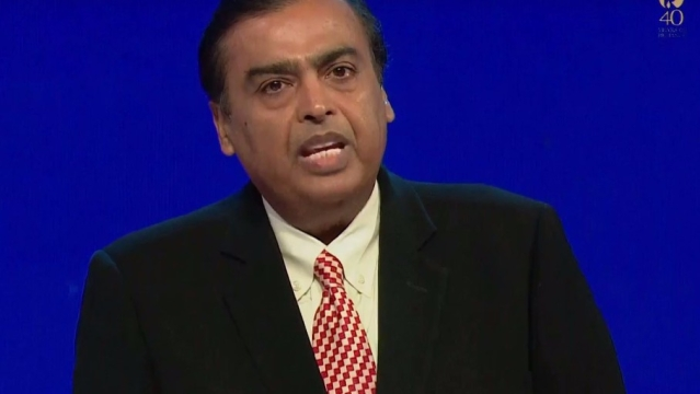 Mukesh Ambani is on stage briefing the media.