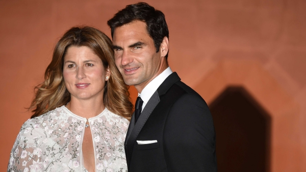 Wimbledon champion Switzerland's Roger Federer and his wife Mirka arrive at the Wimbledon Champions Dinner