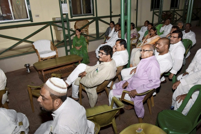 Former Bihar CM and RJD senior leader Rabri Devi with party MLAs watching TV after Nitish Kumar resigned as Bihar Chief Minister in Patna on Wednesday.