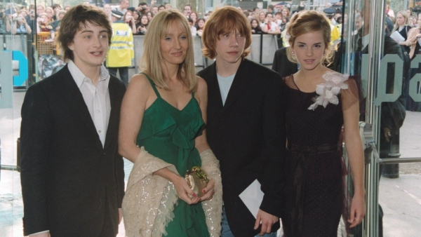 An old photo of the main cast of the Harry Potter movies and author JK Rowling.