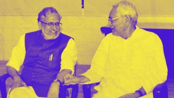Bihar Chief Minister Nitish Kumar with senior leader of BJP Sushil Kumar Modi at legislators meeting in Patna on Wednesday.