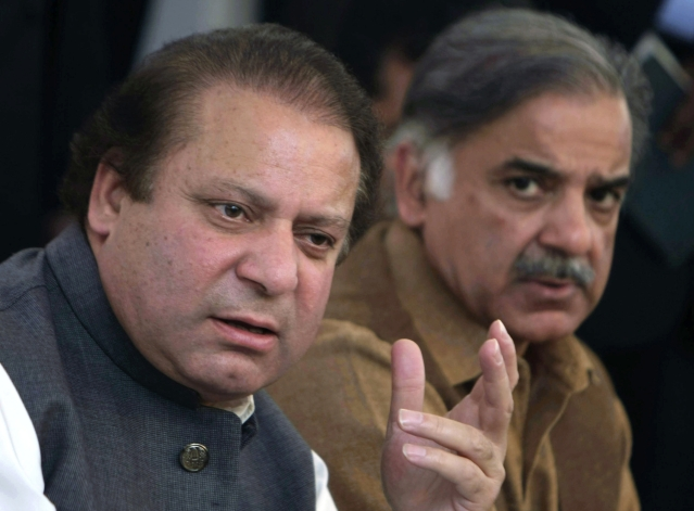 File photo of Pakistan's deposed Prime Minister Nawaz Sharif (L) addressing a news conference with his brother Shahbaz Sharif in Lahore, Pakistan.