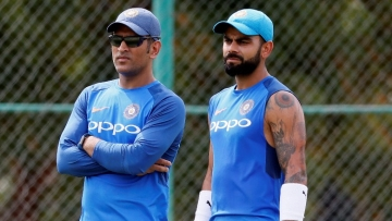 MS Dhoni (L) and Virat Kohli (R) during a practice session.