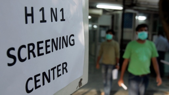 People wearing surgical masks walk out of an H1N1 flu screening centre. Image used for representational purpose.