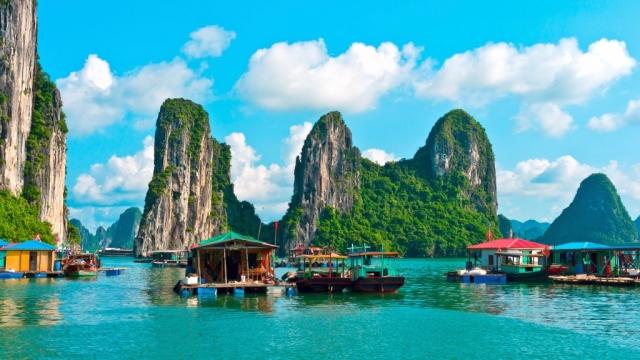 Floating village near rock islands in Halong Bay.