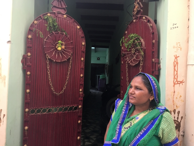 Unsure if she believes in evil spirits or not, Amarvati has hung lemons and neem leaves outside her house.