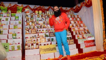 DSS chief Ram Rahim posing with his company's products.