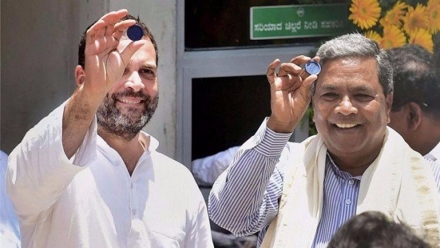 Rahul Gandhi and Siddaramaiah at the inauguration of 'Indira Canteen' in Bengaluru on Wednesday.