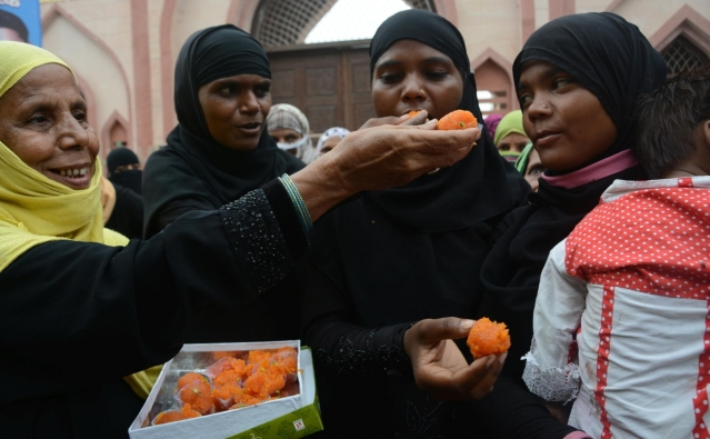 Muslim women celebrate the Supreme court's verdict on Tripal Talaq in Lucknow on 11 August 2017.