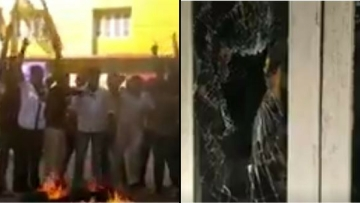 Youth Congress protesters vandalised the I-T office premises and burnt tyres.